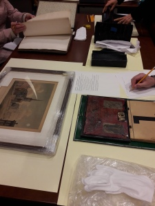 Museum studies students examine artifacts